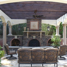 Mediterranean Patio by Carolina Lighting Gallery