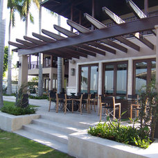 Eclectic Patio by Dorlom Construction