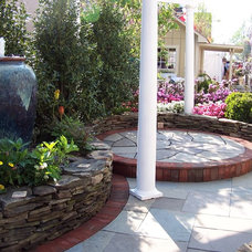 Traditional Patio by Main Street Landscape