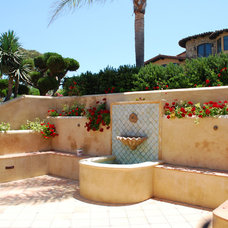 Mediterranean Patio by Southern California Landscape Construction, INC.