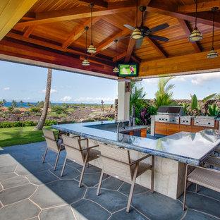 Charmant Patio Kitchen   Tropical Stone Patio Kitchen Idea In Vancouver With A Gazebo