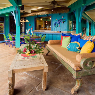 Inspiration for a large tropical backyard patio in Hawaii with a roof extension, an outdoor kitchen and tile.