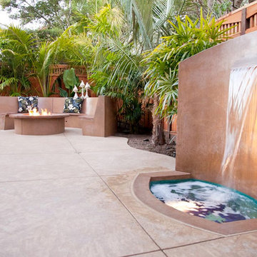 Hawaiian-Style Decorative Concrete Patio w/ Waterfall, Fire Pit & Bench Seating