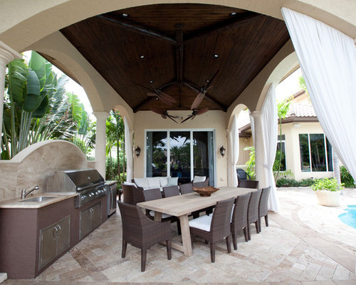 mid sized mediterranean backyard concrete paver patio kitchen idea in miami with a gazebo