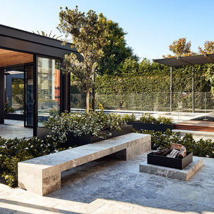 This is an example of a large contemporary patio in Melbourne with tile and no cover.