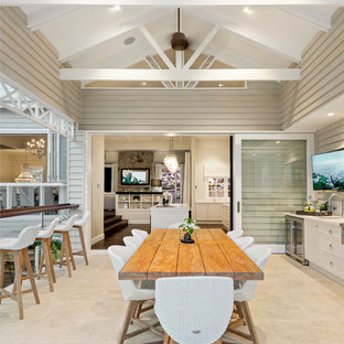 Inspiration for a large beach style patio in Brisbane with an outdoor kitchen, tile and a roof extension.