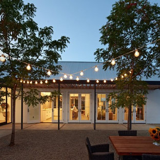 Design ideas for a rural courtyard patio in San Francisco with gravel and no cover.