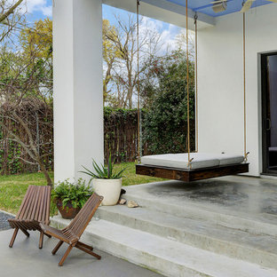 Example of a mid-sized southwest backyard concrete patio design in Houston with a roof extension