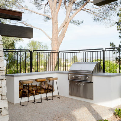 Inspiration for a 1960s backyard concrete patio remodel in Los Angeles with no cover