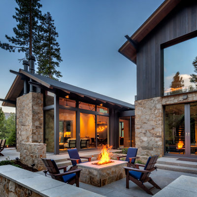 Large mountain style backyard stone patio photo in Sacramento with a fire pit and no cover