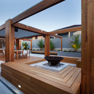 Contemporary patio in Perth with a fire feature, concrete pavers and a pergola.