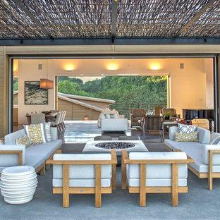Patio - contemporary backyard concrete patio idea in San Francisco with a fire pit and a pergola
