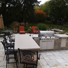Traditional Patio by Grant and Power Landscaping
