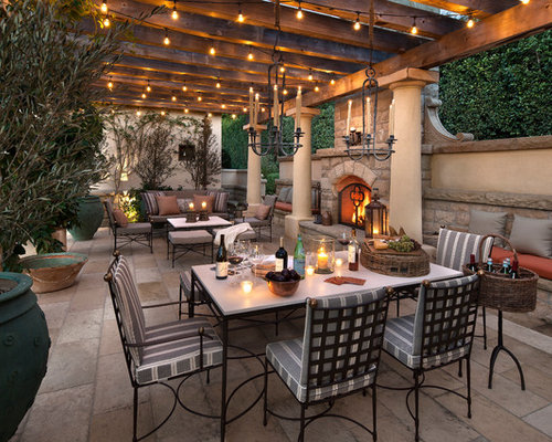 pergola lighting ideas design. example of a tuscan patio design in santa barbara with pergola lighting ideas