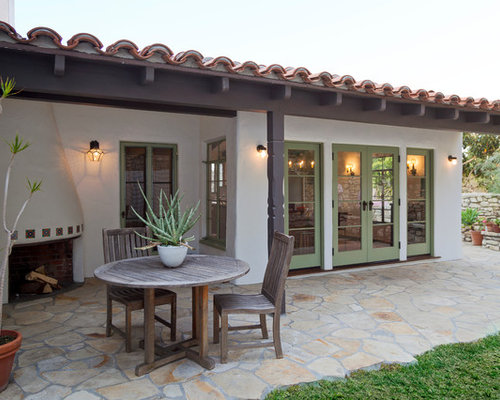 mediterranean patio idea in los angeles with a fire feature - Spanish Style Patio Ideas