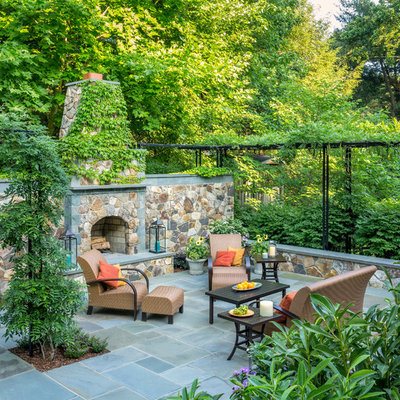 Patio - traditional backyard stone patio idea in DC Metro with no cover and a fireplace