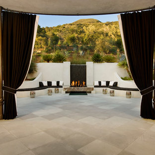Transitional patio photo in Santa Barbara with a fire pit
