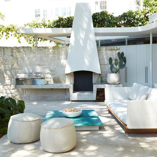 Modern backyard patio in Sydney with no cover.