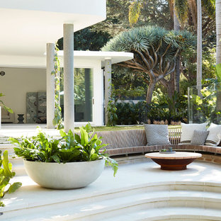 This is an example of a modern backyard patio in Sydney with no cover.