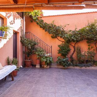 Ispirazione per un grande patio o portico country