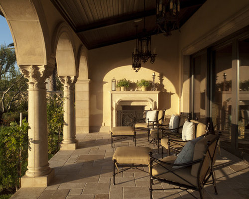 Mediterranean Patio Idea In Orange County With A Fire Pit And A Roof  Extension