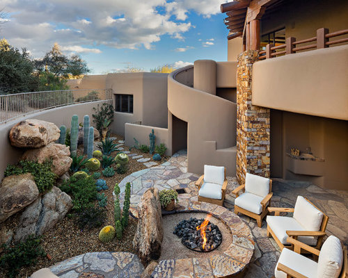 example of a southwest backyard patio design in phoenix with a fire pit - Backyard Patio Design Ideas