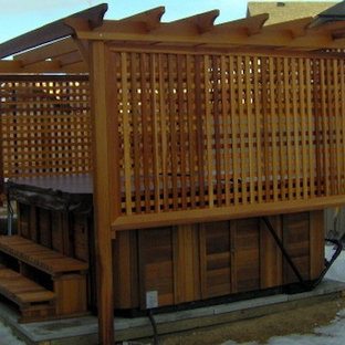 Inspiration for a backyard gravel patio fountain remodel in Calgary with a gazebo