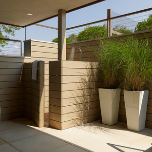 Outdoor patio shower - contemporary outdoor patio shower idea in New York with a roof extension