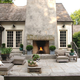 This is an example of a rural patio in New York with a fire feature.