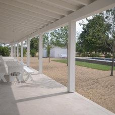 Farmhouse Patio by Houseplans LLC