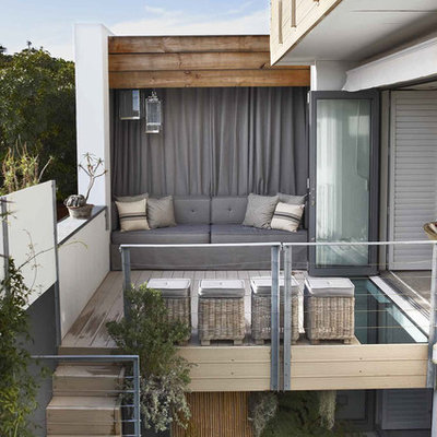 Example of a mid-sized trendy patio design in Other with decking and no cover