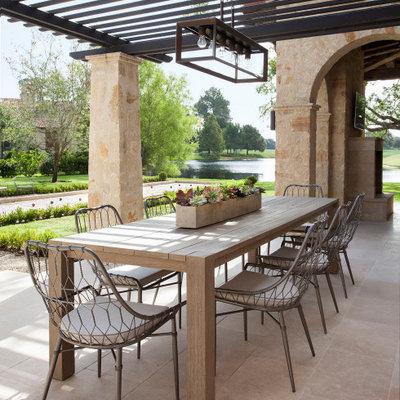 Tuscan patio photo in Houston with a pergola