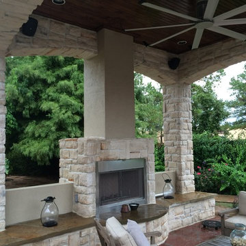 Houston outdoor sitting area with cool arches, warm fireplace