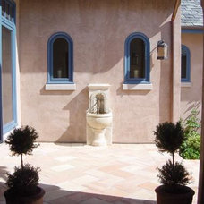 Mediterranean Patio by Doma Architects, Inc.