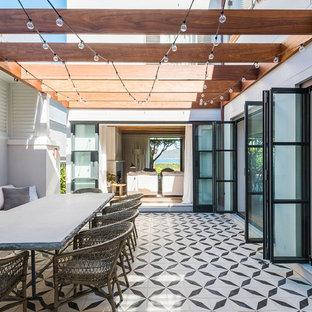 Design ideas for a contemporary patio in Sydney with a pergola.