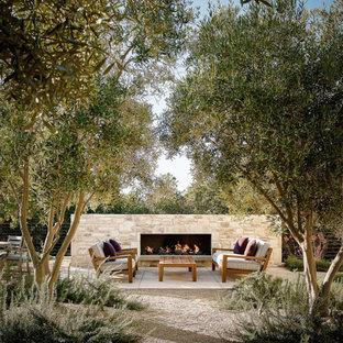 Ispirazione per un patio o portico chic