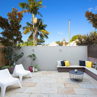 Contemporary backyard patio in Sydney with a container garden, natural stone pavers and no cover.