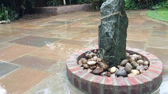Indian Stone Paving with Raised Brick Planter - in Potton, Cambridgeshire