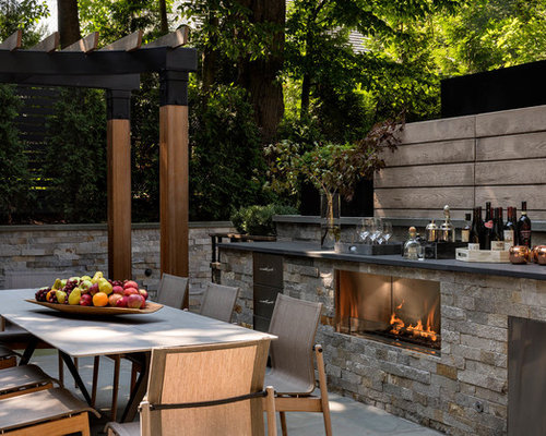 Lovely Example Of A Transitional Patio Kitchen Design In New York With A Pergola