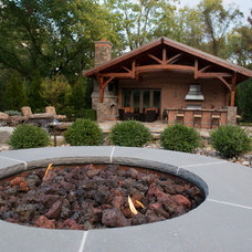 Rustic Patio by Tranquility Pools Inc.