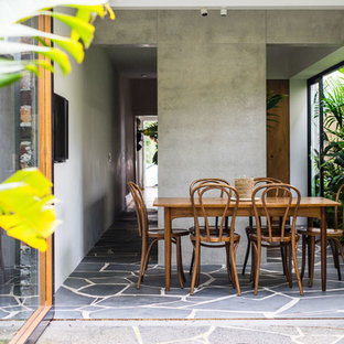 Photo of a tropical side yard patio in Sydney with a roof extension.