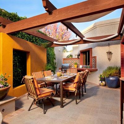 Patio - mediterranean patio idea in Phoenix with a pergola