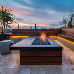 Example of a trendy tile patio design in San Diego with a fire pit