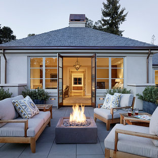 Patio - mid-sized contemporary backyard tile patio idea in San Francisco with no cover and a fire pit