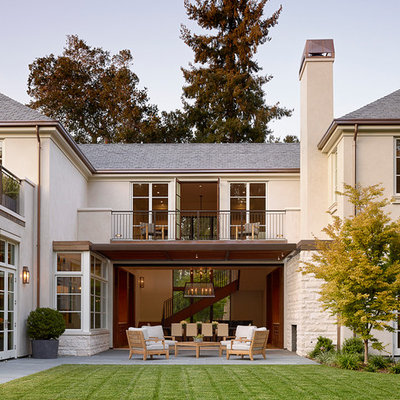 Example of a large classic backyard patio design in San Francisco with a roof extension