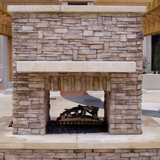 Traditional Patio by Rustic Brick and Stone