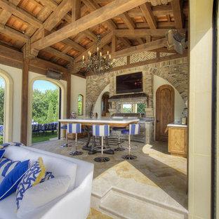 Tuscan backyard tile patio kitchen photo in Minneapolis with a gazebo