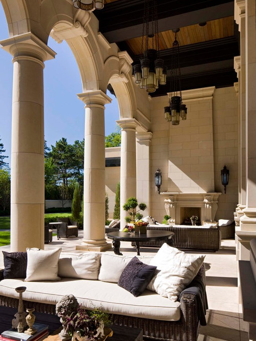 Example Of A Tuscan Patio Design In Minneapolis With A Fire Pit