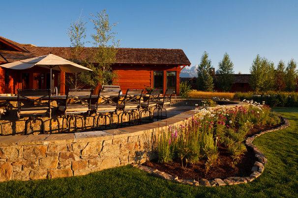 Rustic Patio by Teton Heritage Builders
