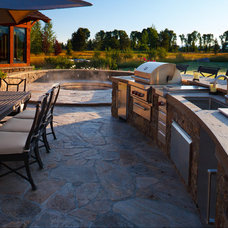 Rustic Patio by Teton Heritage Builders